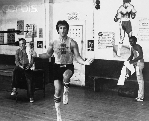 ca. 1979 --- Training for a heavy weight title fight, Rocky Balboa (Sylvester Stallone) skips rope under the watchful eye of his manager, Mickey (Burgess Meredith), and trainer Johnny (Stuart K. Robinson) in . --- Image by © John Springer Collection/CORBIS